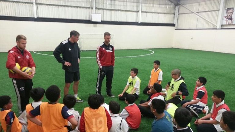 Jamie Carragher delivering a coaching session at his sports academy