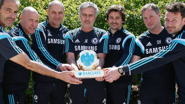 Chelsea manager Jose Mourinho celebrates winning the Barclays Manager of the Season Award with his back room team from Stamford Bridge