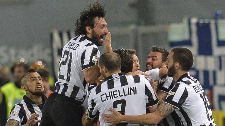 Juventus' forward Alessandro Matri (hidden) celebrates with teammates after scoring during the Coppa Italia final