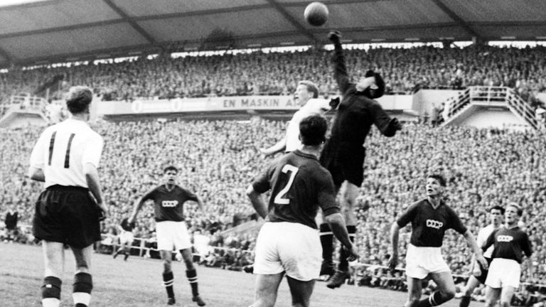 Goalkeeper Lev Yashin (black) from the Soviet Union boxes the ball away from an English player during the World Cup first round soccer match between the So