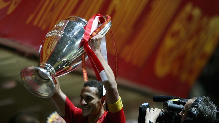 Manchester United's Rio Ferdinand celebrates with the Champions League trophy after beating Chelsea in Moscow in May 2008