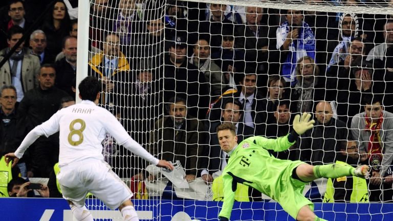 Bayern Munich's goalkeeper Manuel Neuer (R) stops a penalty kick from Real Madrid's Brazilian midfielder Kaka (L) during the UEFA Champions League second l