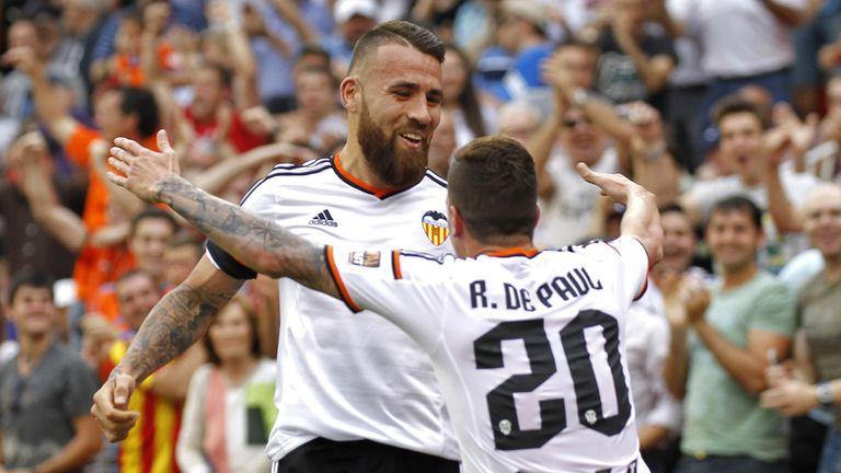 Valencia's Argentinian defender Nicolas Otamendi (L) celebrates with Valencia's Argentinian midfielder Rodrigo de Paul