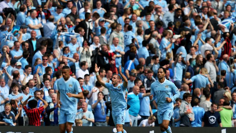 MANCHESTER, ENGLAND - MAY 13:  Pablo Zabaleta (C) of Manchester City celebrates after scoring the opening goal during the Barclays Premier League match bet
