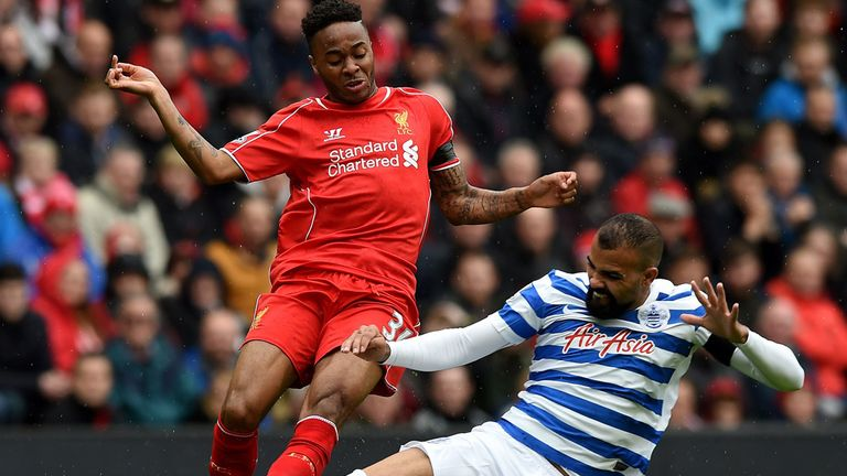 Liverpool winger Raheem Sterling is tackled by QPR's Sandro at Anfield