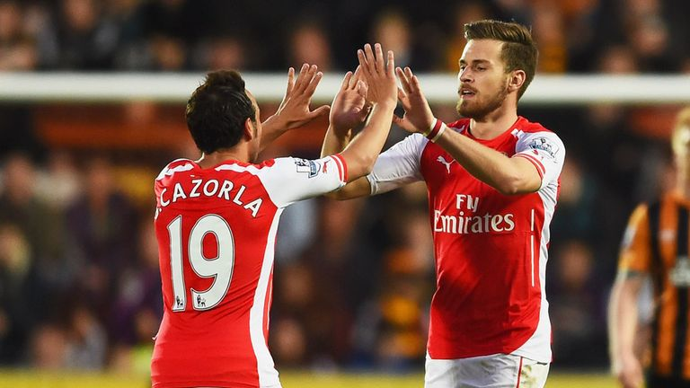 HULL, ENGLAND - MAY 04:  Aaron Ramsey of Arsenal (16) celebrates with Santi Cazorla as he scores their second goal during the Barclays Premier League match