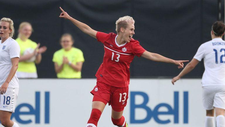 Sophie Schmidt celebrates her goal for Canada against England