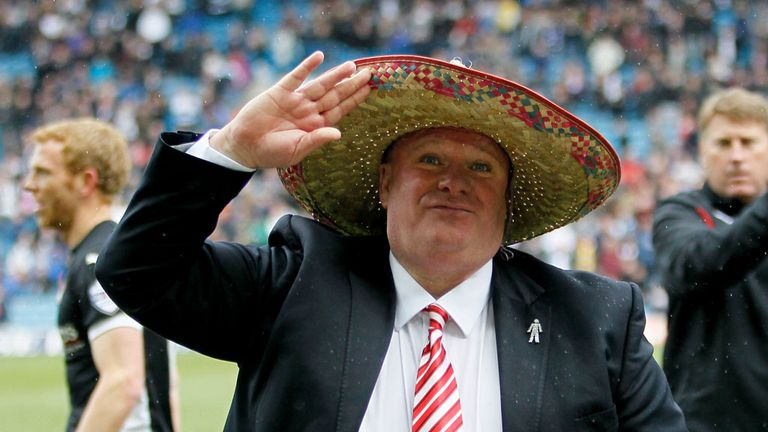 Rotherham manager Steve Evans salutes the fans
