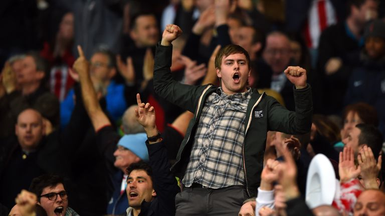 Sunderland fans celebrate on the final whistle as their team avoid relegation during the Barclays Premier League match between Arsenal and Sunderland
