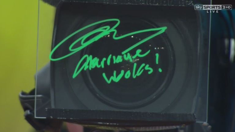 """Murray wrote """"Marriage Works!"""" on the lens of a television camera"""