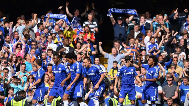 Chelsea players and fans celebrate the opening goal scored by Chelsea's John Terry.