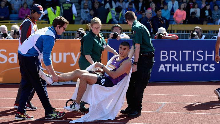 Adam Gemili is carried away in a wheelchair at the end of the race