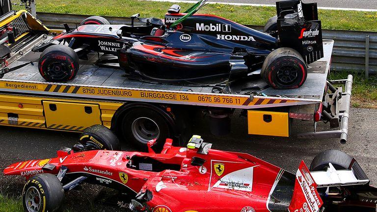The wrecked cars of Fernando Alonso and Kimi Raikkonen