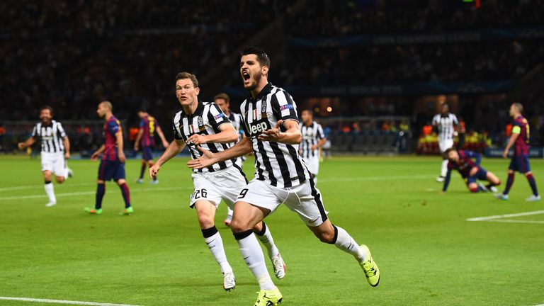 Alvaro Morata of Juventus celebrates scoring his team's first goal with Stephan Lichtsteiner during the UEFA Champions League Final