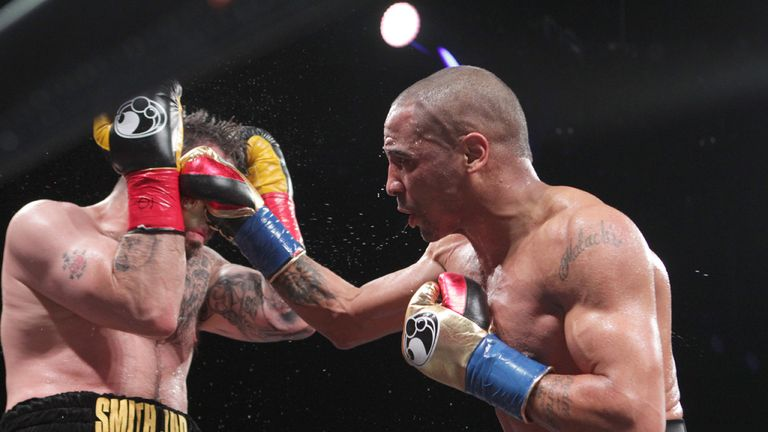 Andre Ward throws a right hook against Paul Smith