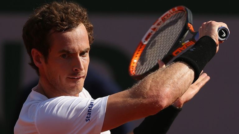 Andy Murray plays a backhand in his French Open semi-final match against Novak Djokovic