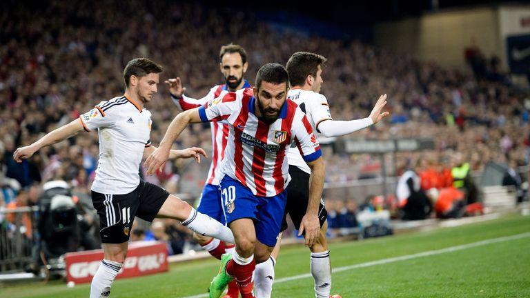 Arda Turan demonstrates his dribbling abilities against Valencia