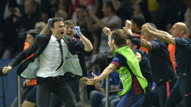 Barcelona's coach Luis Enrique (L) celebrates at the end of the UEFA Champions League Final football match between Juventus and FC Barcelona