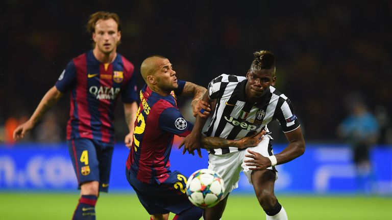 Paul Pogba of Juventus battles for the ball with Daniel Alves of Barcelona