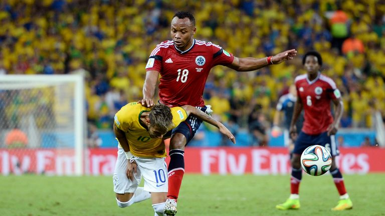 Neymar of Brazil is challenged by Juan Zuniga of Colombia during the 2014 World Cup quarter-final
