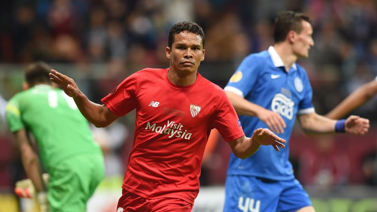 Sevilla's Carlos Bacca reacts after scoring