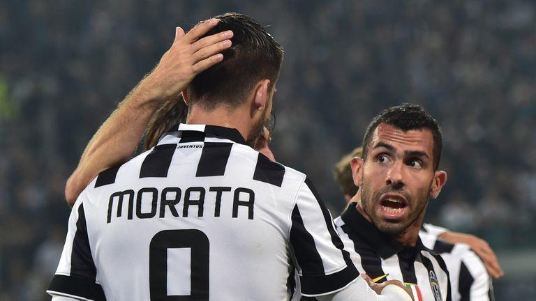 Juventus' forward from Spain Alvaro Morata is congratulated by Carlos Tevez