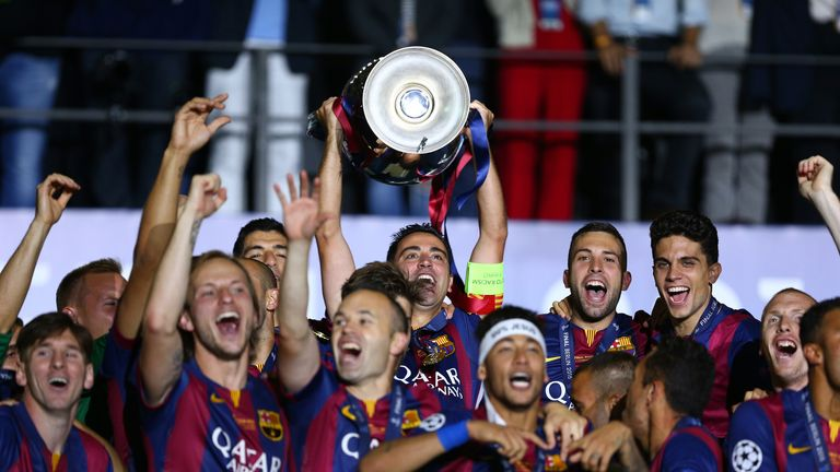 Xavi of Barcelona lifts the trophy as he celebrates victory with team mates after the UEFA Champions League Final between Juventus and FC Barcelona