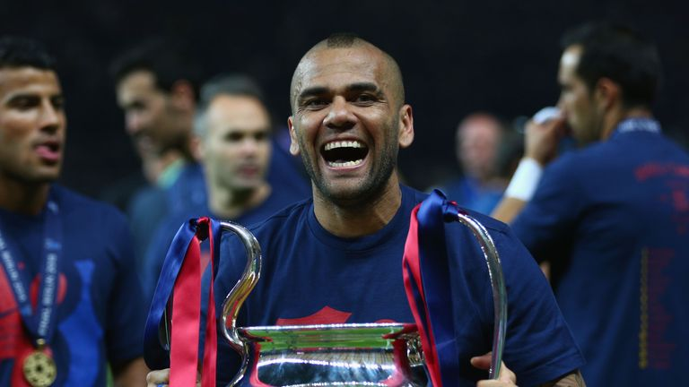 Daniel Alves of Barcelona celebrates with the trophy after the UEFA Champions League Final between Juventus and FC Barcelona in Berlin