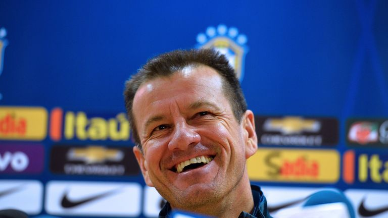Brazil boss Dunga all smiles in a press conference