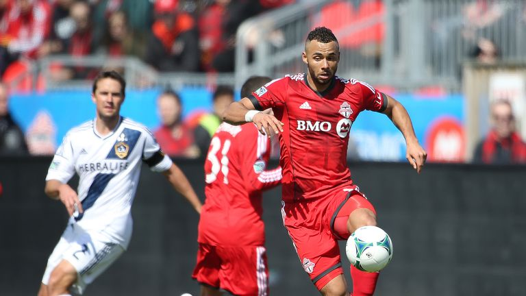 TORONTO, CANADA - MARCH 30:  John Bostock #7 of Toronto FC grabs a ball in an MLS game against the Los Angeles Galaxy on March 30, 2013
