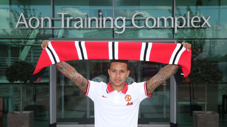 Memphis Depay poses at Manchester United's Aon Training Complex.