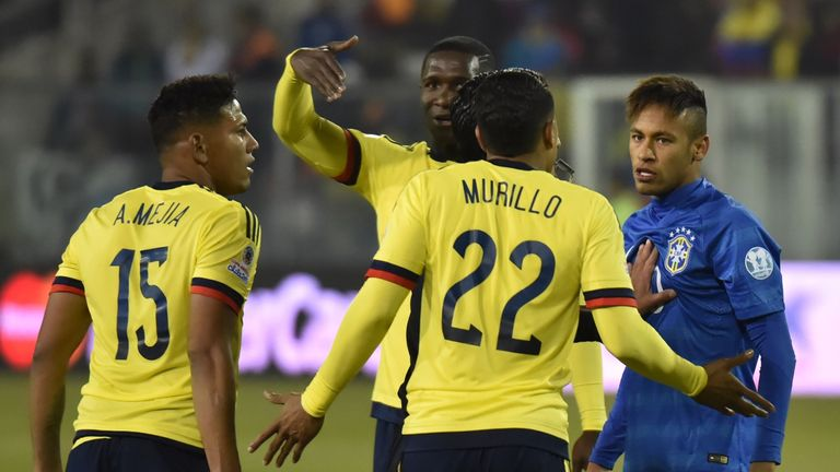 Neymar (right): Argues after headbutting Colombia's Jeison Murillo