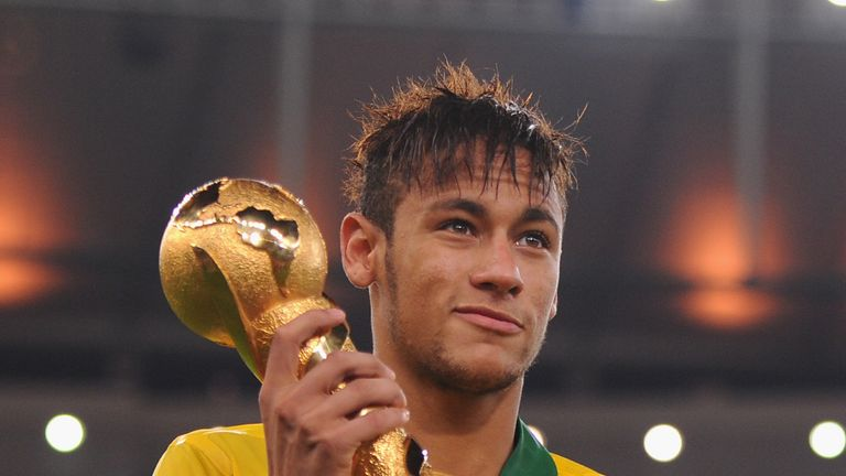Neymar of Brazil poses with the trophy after the FIFA Confederations Cup Brazil 2013 Final