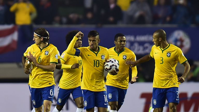 Neymar celebrates his early equaliser for Brazil against Peru