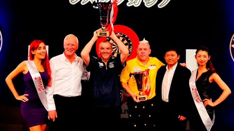Phil Taylor celebrates his Japan Darts Masters success