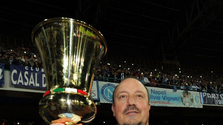Rafael Benitez head coach of Napoli poses with the Tim Cup before the Serie A match between SSC Napoli and Cagliari Calcio