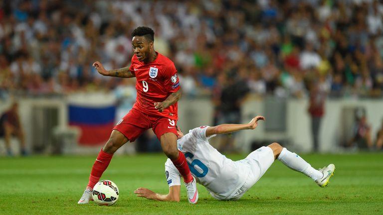 England player Raheem Sterling skips past Branko Ilic of Slovenia during the UEFA EURO 2016 Qualifier