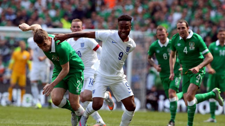 Republic of Ireland's Seamus Coleman vies with England's Raheem Sterling during the international friendly at Aviva Stadium in Dublin on June 7, 2015.