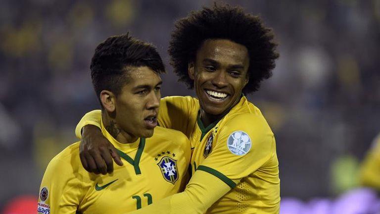 Willian (right) celebrates Brazil's second goal with Roberto Firmino.
