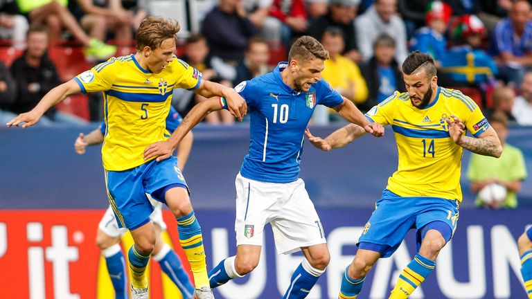 Ludwig Augustinsson and Mikael Ishak compete for the ball with Italy's Domenico Berardi