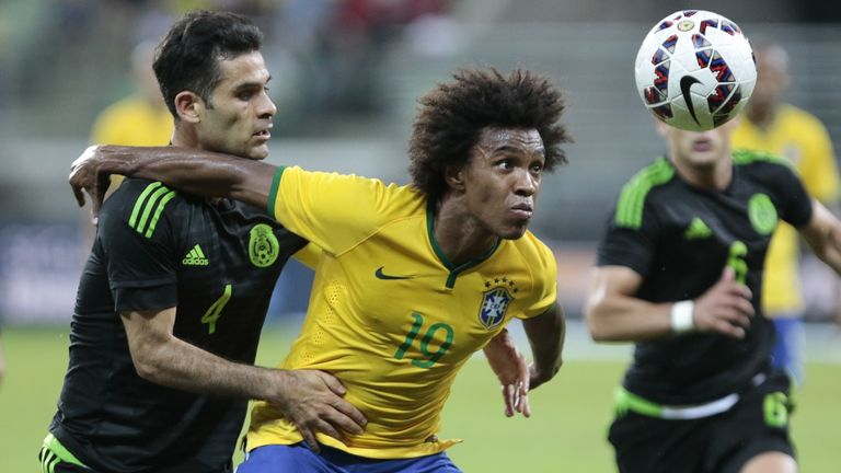 Brazil's Willian and Mexico's Rafa Marquez in friendly action ahead of the Copa America