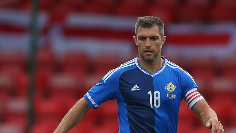 Aaron Hughes will win his 100th cap if he plays against Belarus