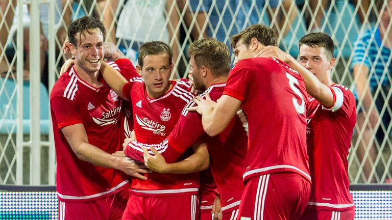 Aberdeen's Andrew Considine (left) celebrates after putting his side 1-0 up in Croatia