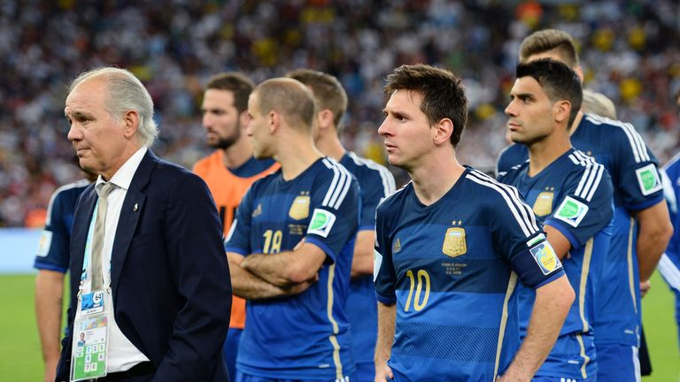 Head coach Alejandro Sabella of Argentina looks on with Lionel Messi after being defeated by Germany 1-0 in extra time of the 2014 World Cup final
