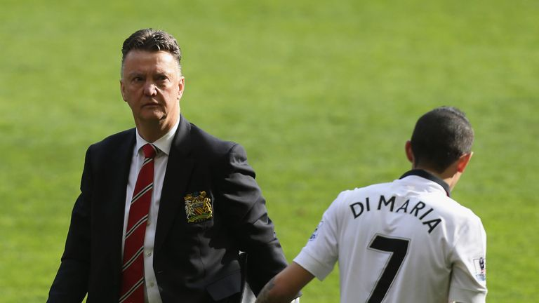 Manager Louis van Gaal and Angel Di Maria  of Manchester United celebrate after the Premier League match between Liverpool and Manchester United