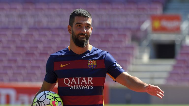 Barcelona's new player Arda Turan gestures during his official presentation at the Camp Nou stadium in Barcelona