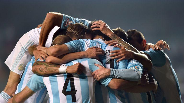 Argentina's midfielder Javier Pastore celebrates with teammates