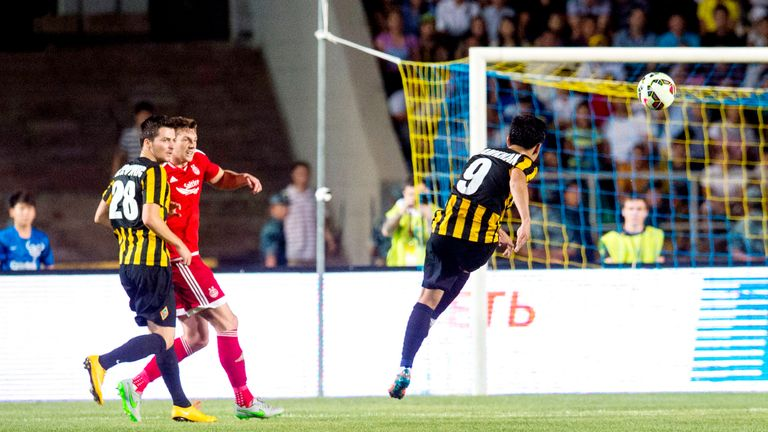 Kairat Almaty's Bauyrzhan Islamkhan fires the ball towards goal to double his side's lead against Aberdeen.