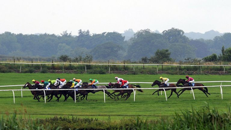 Runners and riders in the Producers Nursery race at Catterick Racecourse.