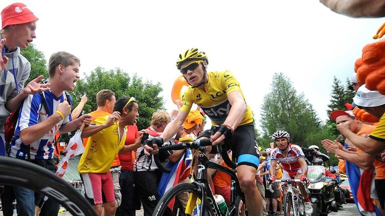 Chris Froome arrives at Dutch Corner on Alpe d'Huez on his way to Tour victory in 2013